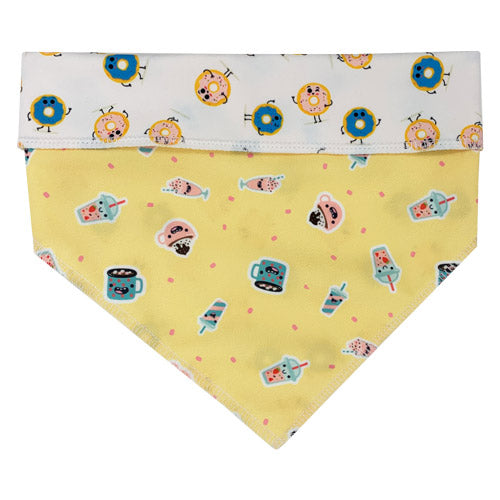 Super cut reversible dog bandana with a yellow side with drinks on top and reverse side of white with pink and blue doughnuts from Swanky Paws