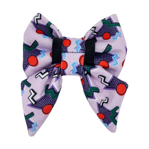 back side of the purple 90s style sailor dog bow tie from Swanky Paws with elastic loops