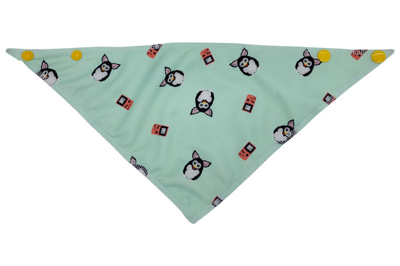 cute green dog bandana with little furby figures and orange game boys on reversible dog bandana