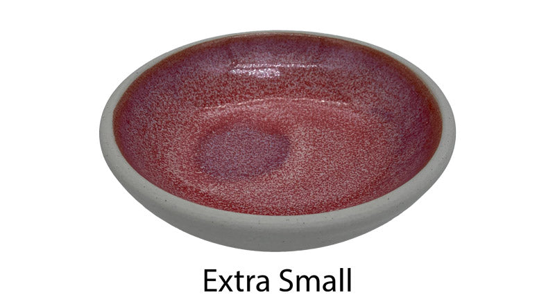 Best pink dog bowl in Australia showing the pink watermelon coloured glazing on the inside and the smooth clay on the outside. This is the extra small size