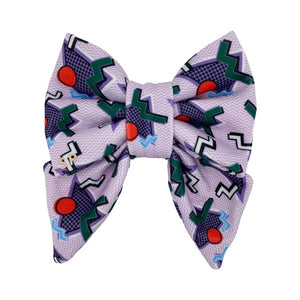 purple sailor dog bow featuring green zig zags and red circles etc. Size medium made from Swanky Paws in Australia