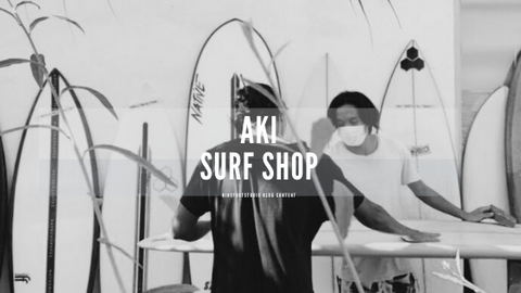Aki surf a board shaper doing his shaping turning back from the camera