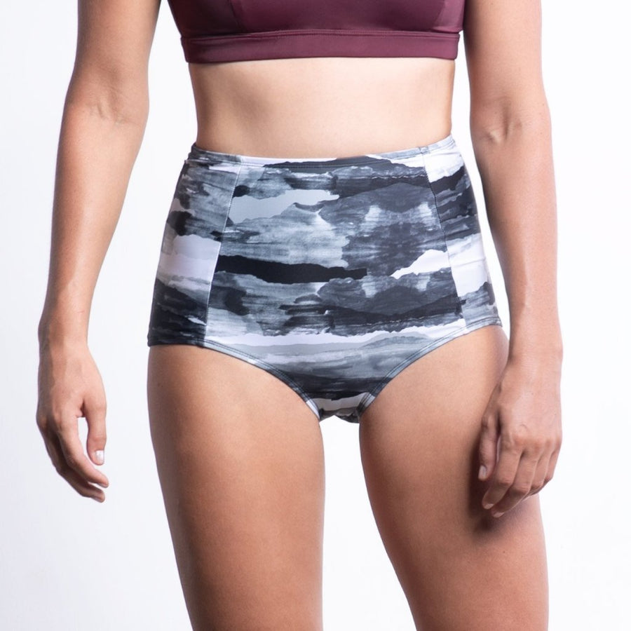 ninefoot Sanur women surf bikini bottom high waist recycled ocean plastic storm print