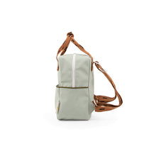 The Woods Sticky Lemon Sprinkles small backpack recycled plastic bottles sustainable sage green cinnamon brown moss green