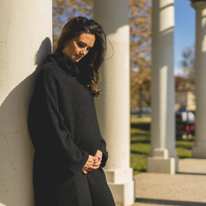 shop the woods Audrey and Olive chunky turtleneck cable knit oversized black maternity