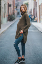 shop the woods Audrey and Olive chunky turtleneck cable knit oversized green khaki military maternity