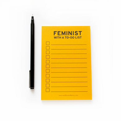 Feminist with a To Do List Notepad
