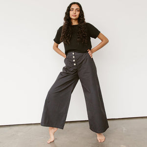 The Woods Neve and Hawk Sunrise Pant wide leg cotton button fly washed black