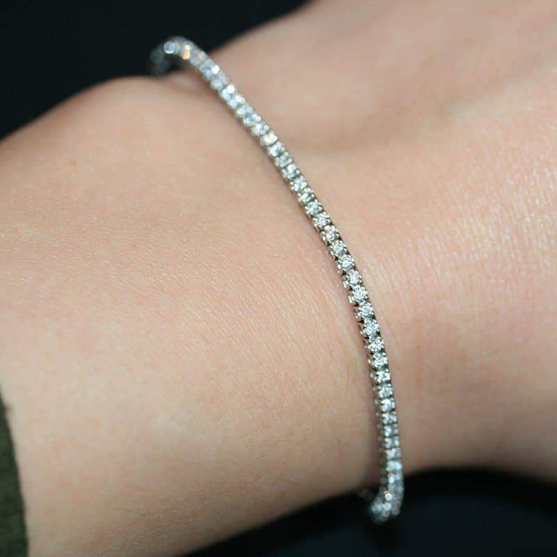 White gold diamond bracelet on a lady's wrist.