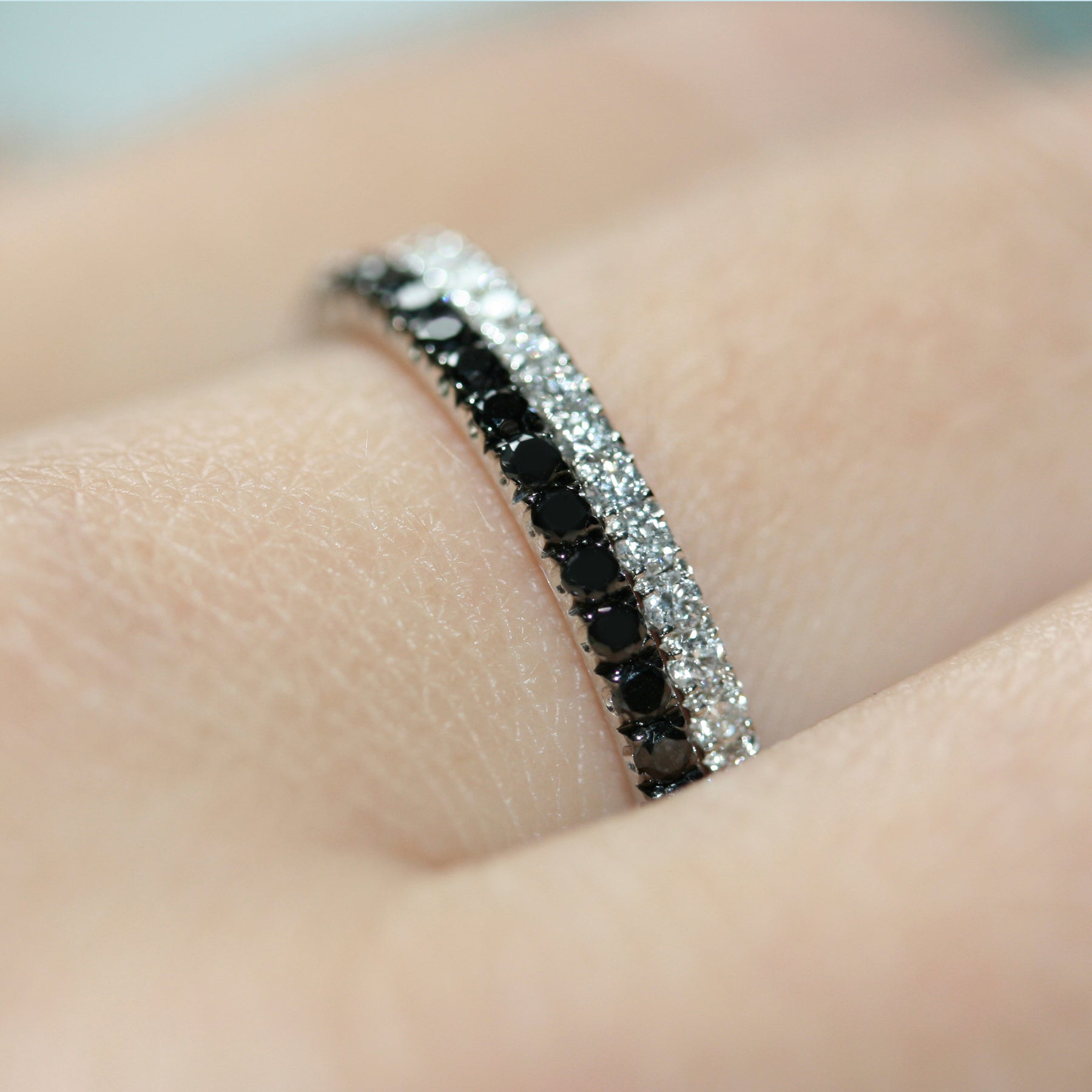 black and white diamond eternity ring pair 18ct white gold