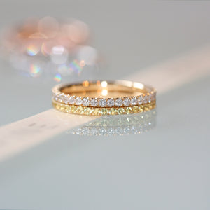 diamond and yellow sapphire ring pair