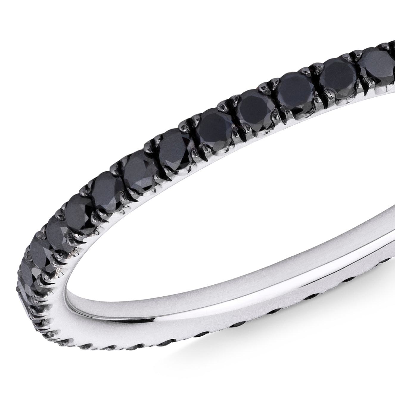 Closeup image of a black diamond eternity ring with 18 carat white gold on a white background