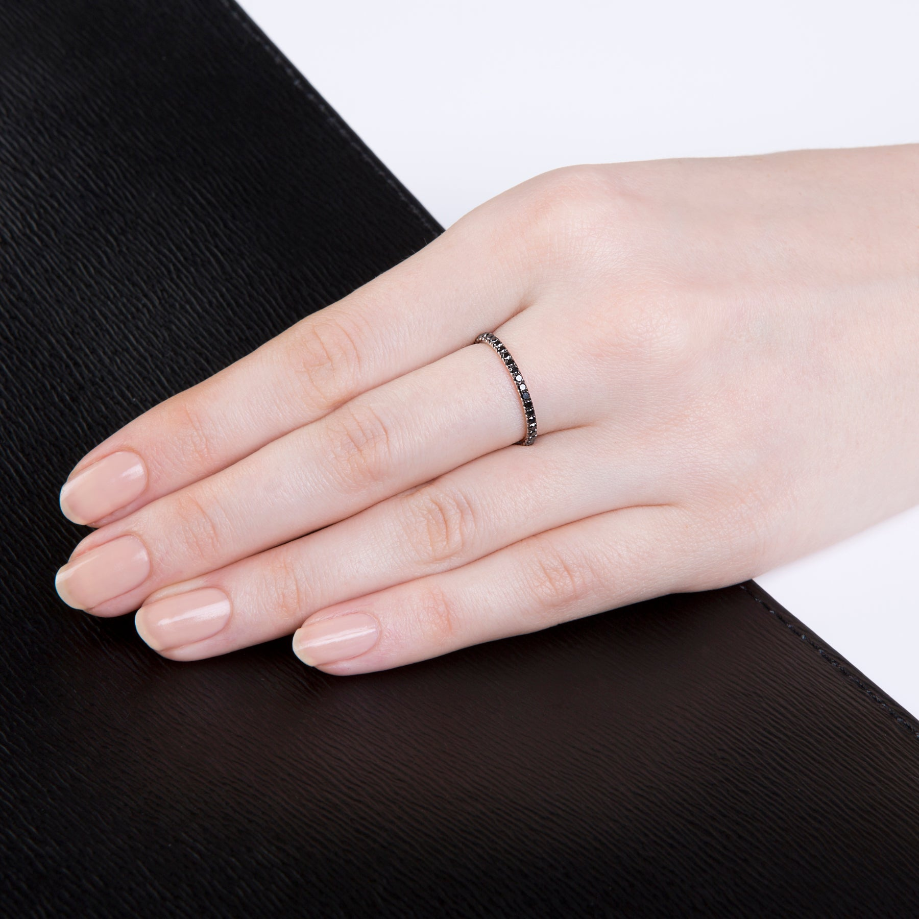 Image of Verifine black diamond ring with 18 carat white gold on a lady's hand