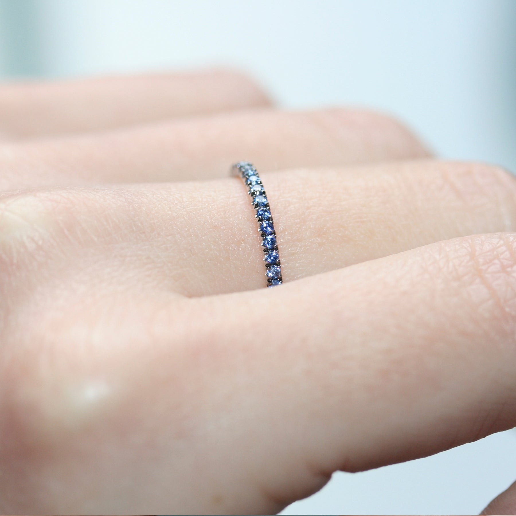 stacking blue sapphire eternity ring