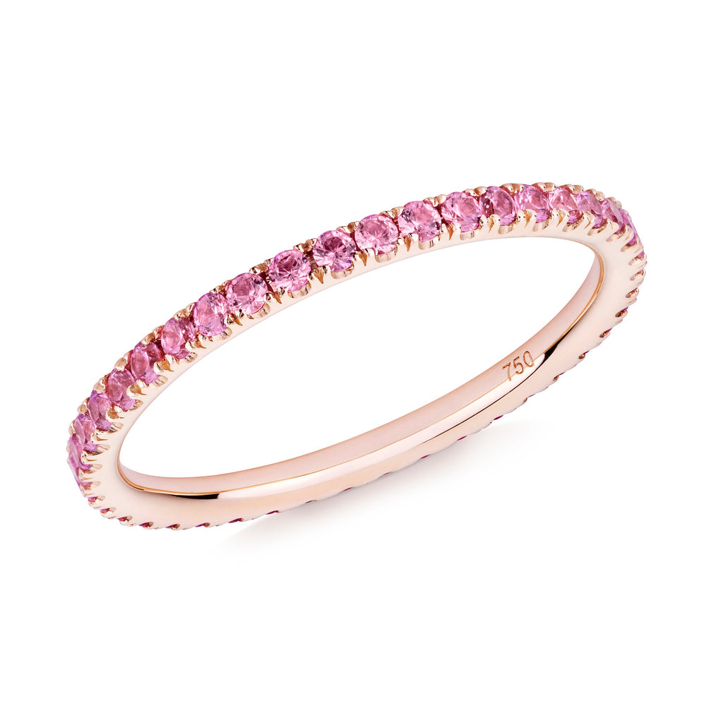 Pink sapphire eternity ring in 18ct rose gold on a white background.