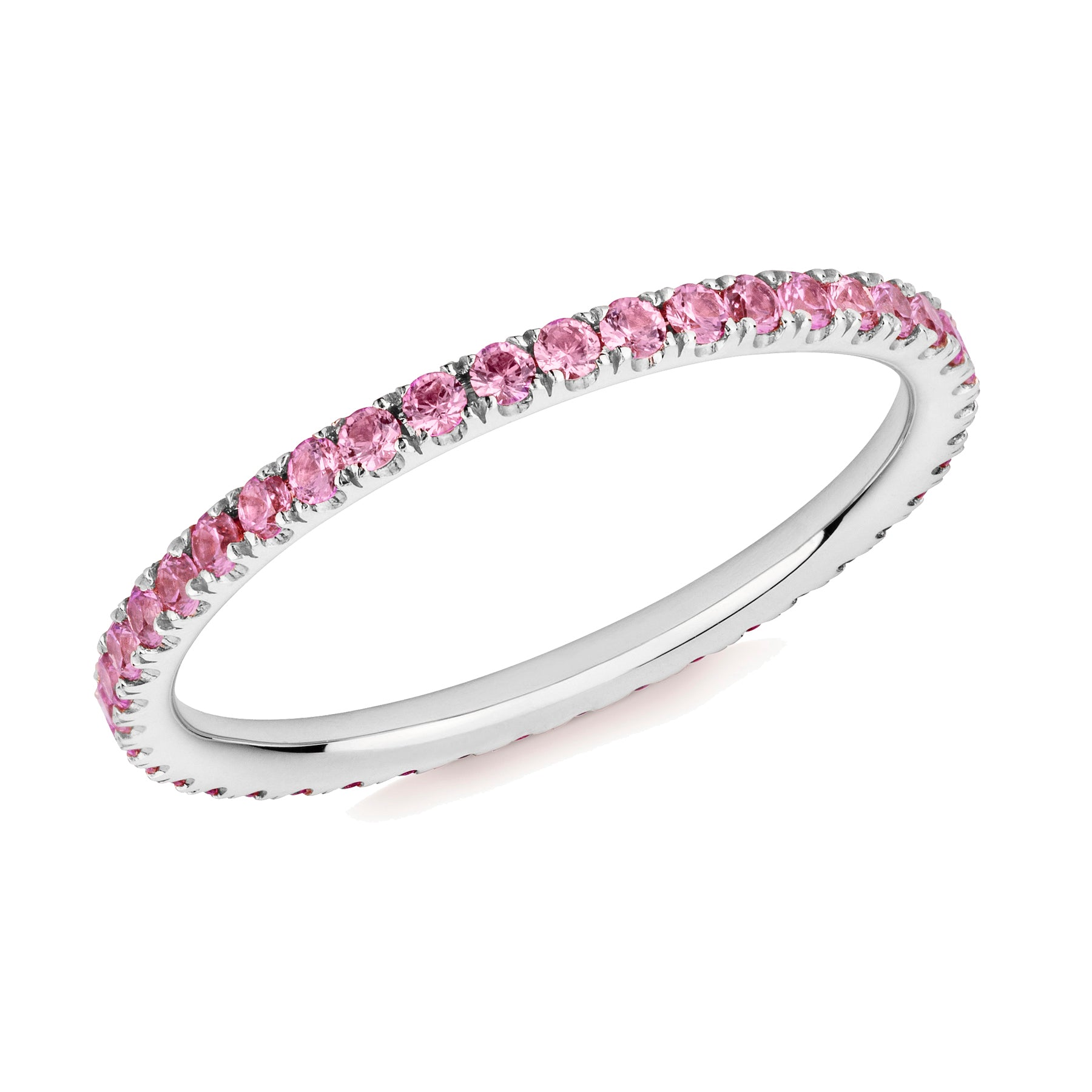 Pink sapphire eternity ring in platinum on a white background.