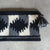 """Ortega pattern clutch bag"""