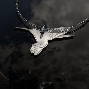 humming bird pendant. .925 Sterling charm and chain