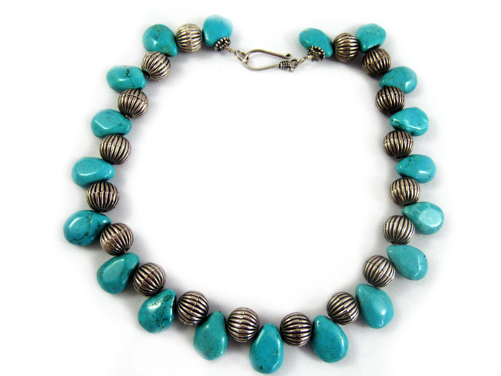 Pear shaped Turquoise Howlite drops between ridged antiqued round beads necklace