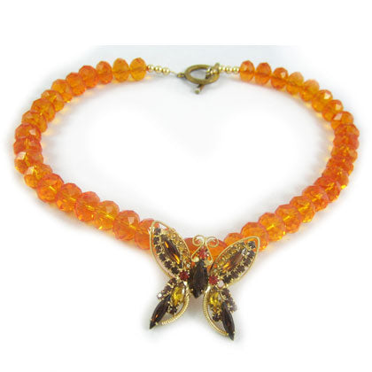 Beautiful rhinestone butterfly with translucent orange glass beads