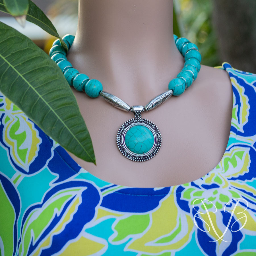 Turquoise Medallion Necklace in a shade of blue outfit