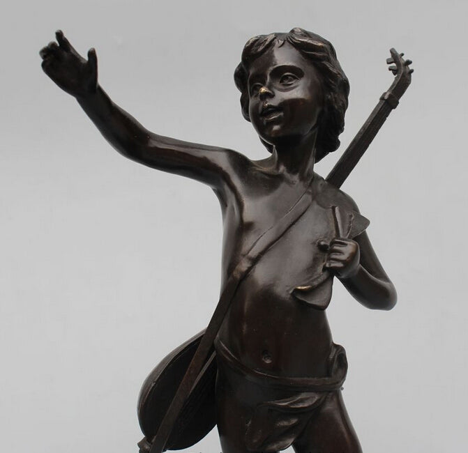 Cast bronze guitar cherub boy