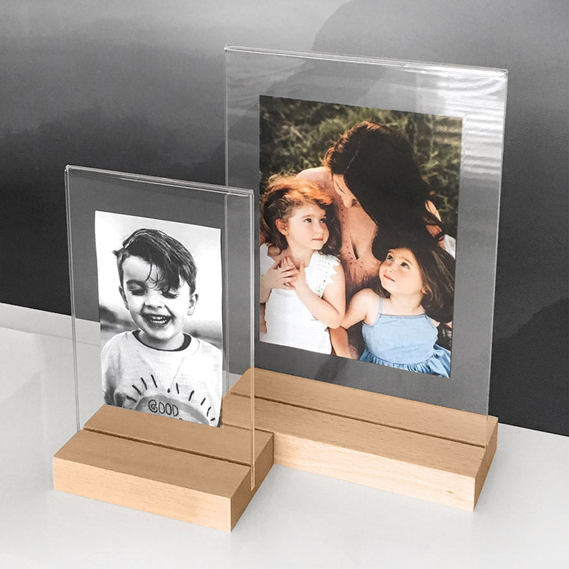 Clear Acrylic Photo Frames with Natural Wood Base, showcasing some family photos inside