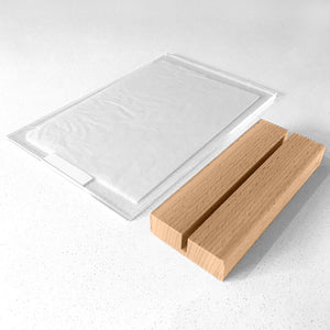 Clear Acrylic Photo Frame with Natural Wood Base, showing all components laid flat on table