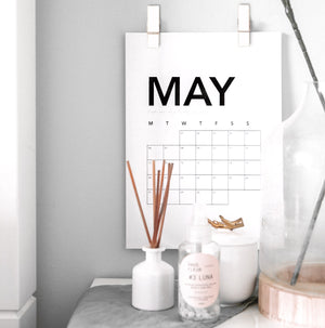 Wall pegs pair in a wall, hanging a calendar
