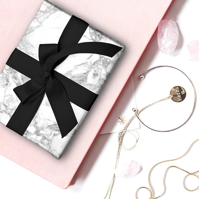 Load image into Gallery viewer, White Marble gift wrapping paper wrapped around a gift with black ribbon