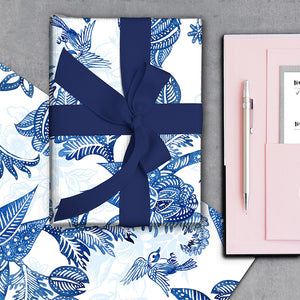Hamptons Chinoiserie Paisley gift wrapping paper wrapped around a gift with navy ribbon