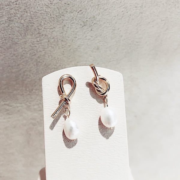 Mesmerising Golden Knot earrings with dangling pearls