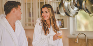A picture of a happy couple in Alexander Del Rossa bathrobes.