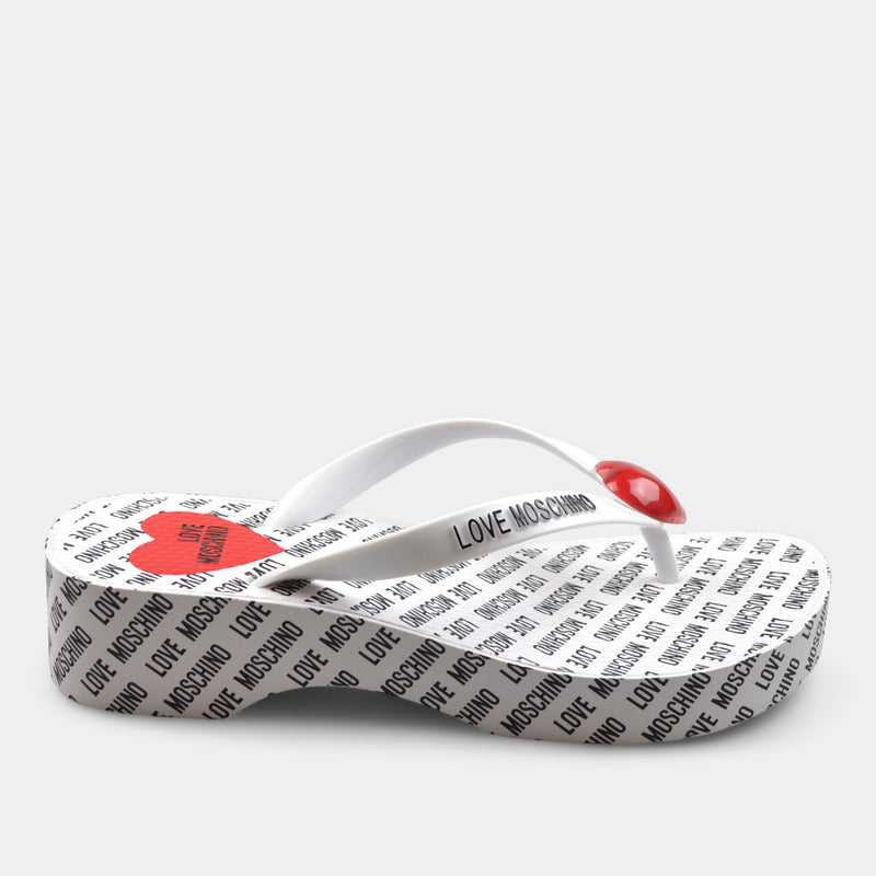 LOVE MOSCHINO LOW HEEL FLIP FLOPS IN WHITE