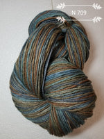 Brown, gold, light and medium tone teal blue