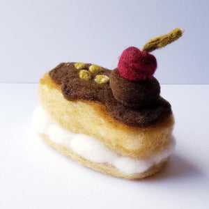 Chocolate Eclair with Pistachios and Cherry
