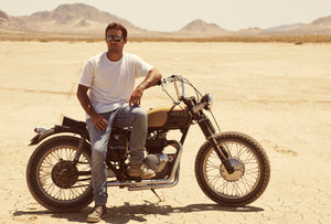 Man sitting on a motorcycle, wearing the Elsinore sunglasses
