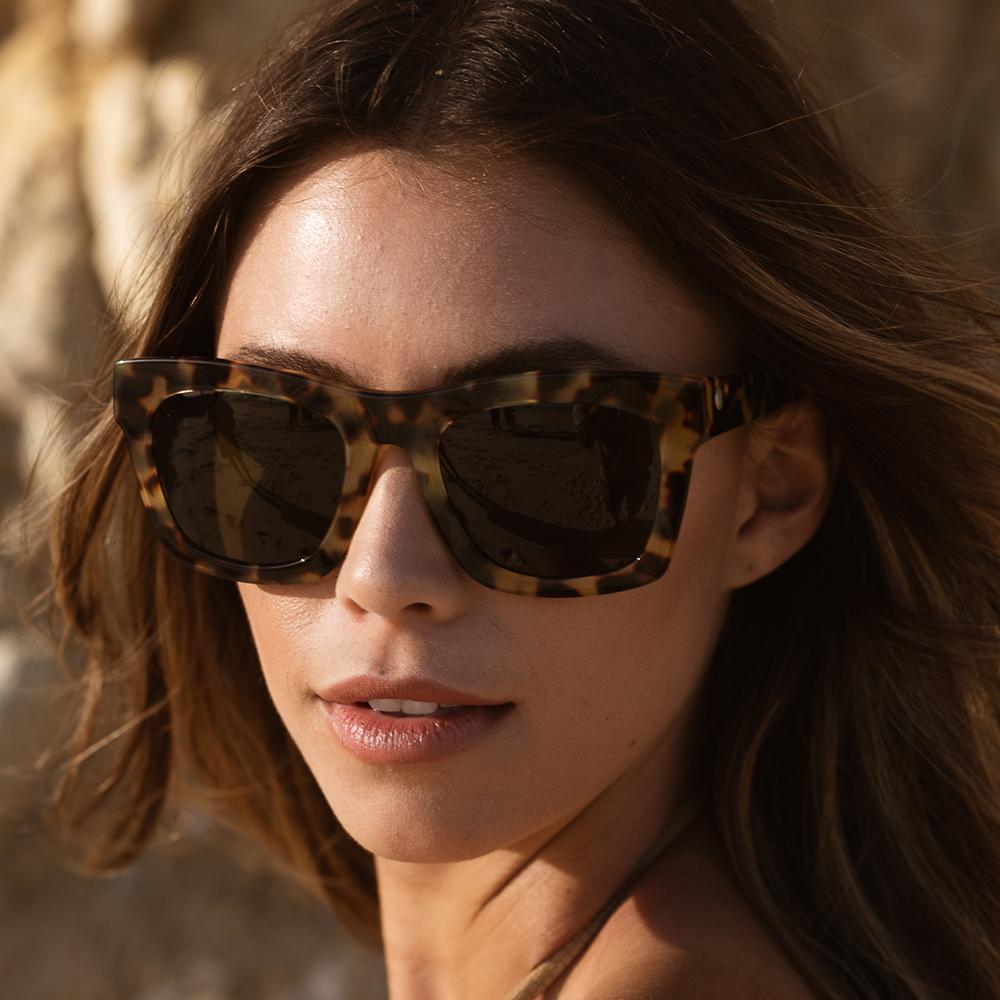 Women wearing the Crasher Sunglass in Gloss Tort