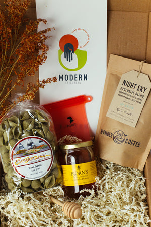 Modern Epicurean Fall 2018 Curated Local Food Gift Box with Wander Coffee, Bjorn's Traditional Raw Honey, Papardelle's Basil Garlic Pasta, Wooden Honey Dipper, and POINT. Sandwich Bags