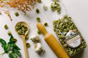Handmade Basil Garlic Pasta Shells Crafted By Pappardelle's Pasta In Denver, Colorado.