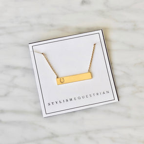 stylish equestrian dainty bar necklace with horseshoe cutout gold