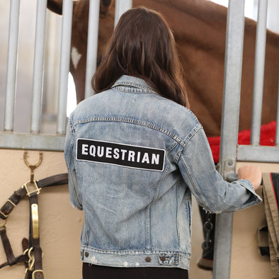 stylish equestrian denim jacket with black and white equestrian patch