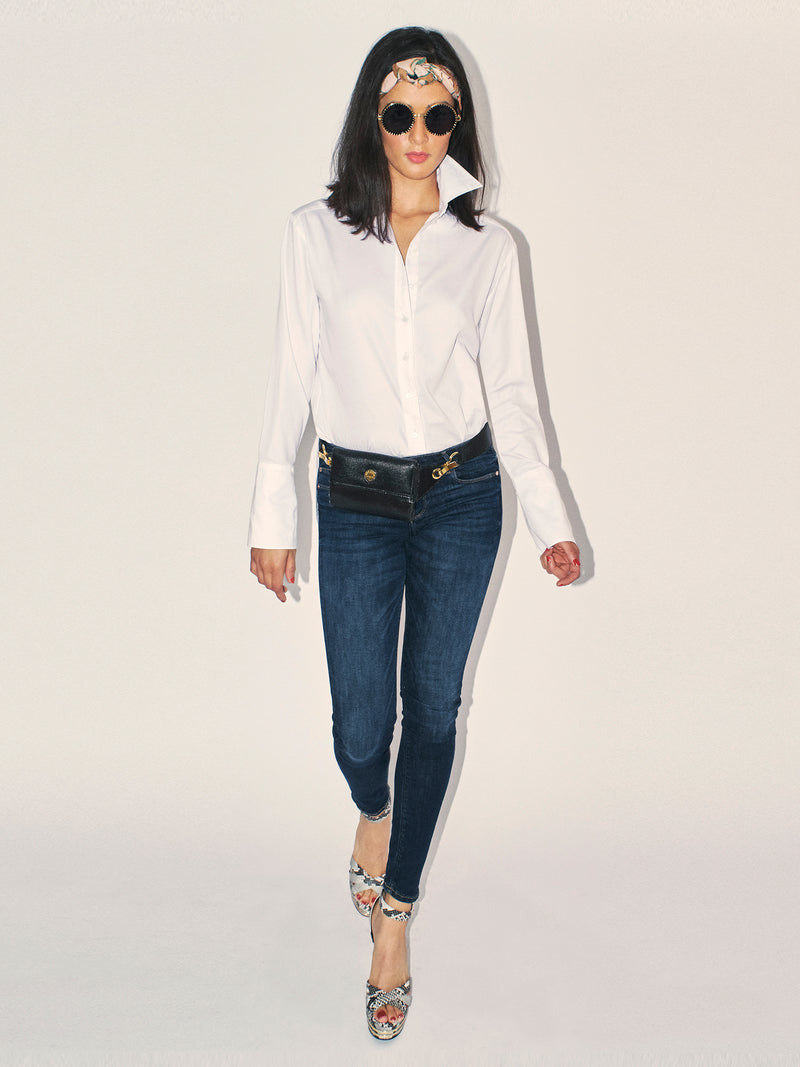 The perfect white shirt. Classic Six Donna White shirt. Season-less, crisp cotton button-down blouse with extra-long cuff, side slits, French seams, grosgrain detailing, and uniquely positioned pearl buttons for ideal fit.