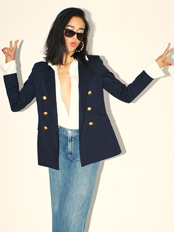 The perfect double-breasted blazer. Classic Six Katharine Double-breasted navy blazer. Season-less, double-breasted blazer in Ponte de Roma knit, with contrasting ivory piping and felt under-collar, grosgrain detailing and custom-designed antiqued-gold buttons.