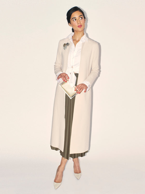 The perfect year-round coat. Classic Six Jackie Duster Coat. Season-less, mid-calf duster coat in Ponte de Roma knit. Unlined with bias-taped seams, slash pockets, contrasting grosgrain side detailing, with removable belt for additional styling.