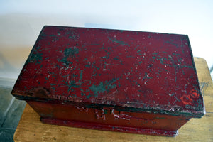 Antique red storage trunk