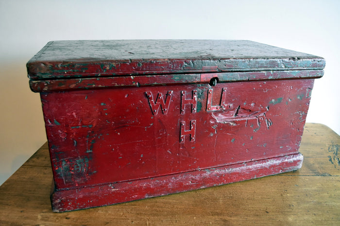 Fantastically-aged antique red storage trunk