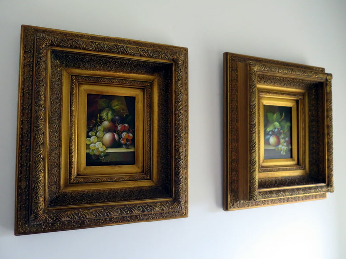 Pair of small oil paintings in ornate gilt gesso frames