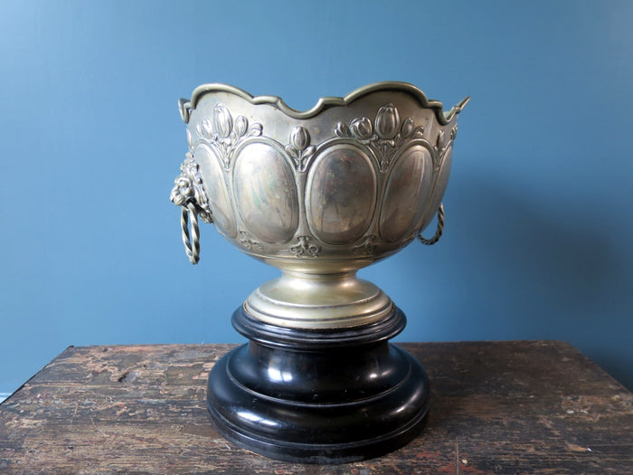 Silver plated champagne bucket on ebonised plinth