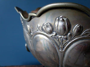 Antique silver plated champagne bucket on ebonised plinth